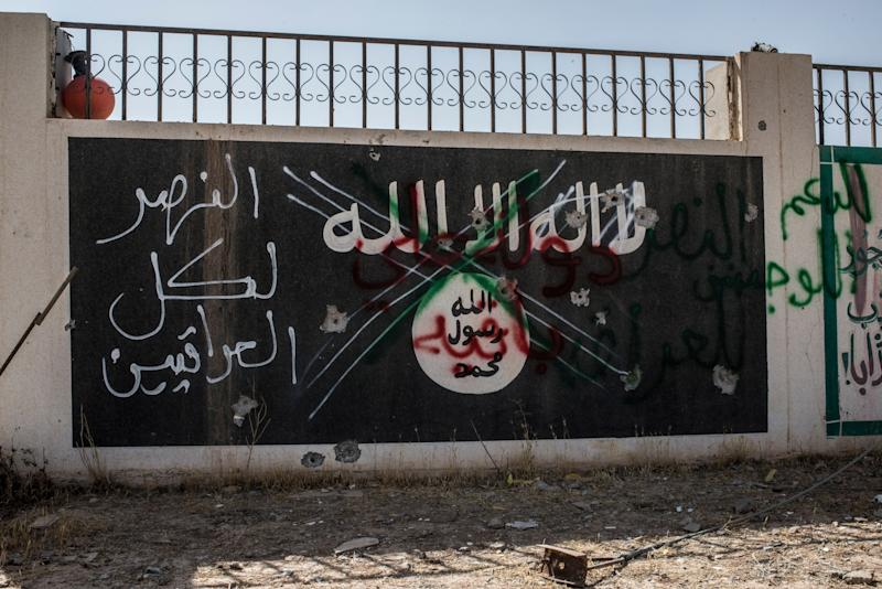 An Islamic State sign in the north-western Iraq town of Ba'aj, June 20, 2017, near the Iraq-Syria border. (Photo: Martyn Aim/Getty Images)