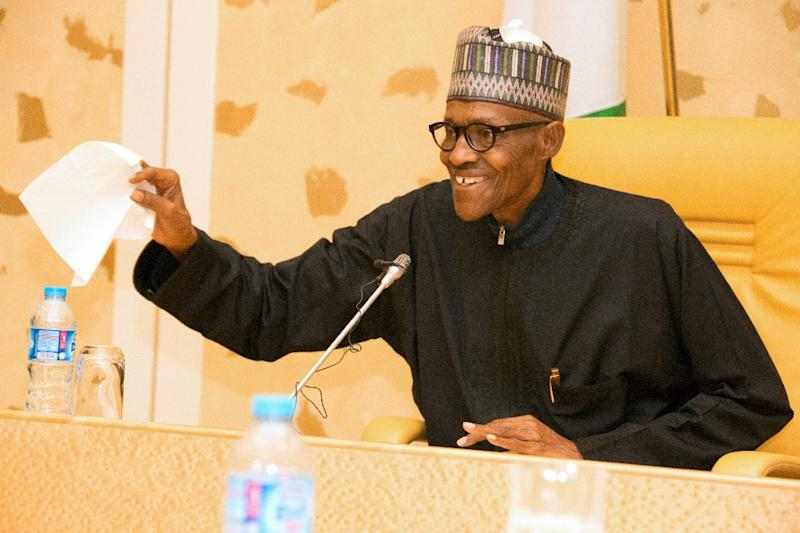 Buhari was nicknamed 'Baba go slow' for his lethargic pace in office (AFP Photo/SUNDAY AGHAEZE)