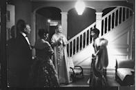 <p>Kelly chats with guests in her home before departing for the the 1955 Academy Awards. That night, she won the Best Actress Oscar for <em>The Country Girl</em>, beating Judy Garland.</p>