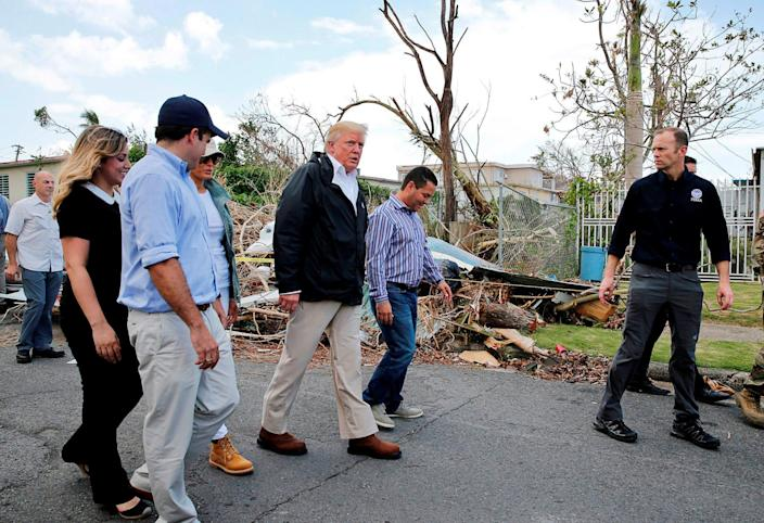Image: President Trump walks past hurricane wreckage as he visits areas damaged by Hurricane Maria in Guaynabo, Puerto Rico (Jonathan Ernst / Reuters file)