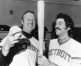FILE - Al Kaline of the Detroit Tigers, left, shows his teammate Aurelio Rodriguez the bat and ball he used to hit his 3,000 hit in major league baseball in Baltimore, in this Sept. 24, 1974, file photo. The past year has not been good for 1970s baseball, with the deaths of a multitude of the decade's mainstays and heroes. Kaline died April 6, 2020. (AP Photo/William A. Smith, File)