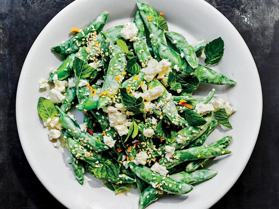 """<p>Be sure to pat the snap peas thoroughly dry before tossing with the creamy yogurt-feta dressing so the dressing coats the peas instead of slipping off. Fresh mint gives this dish a decidedly <a href=""""https://www.myrecipes.com/greek-recipes"""" rel=""""nofollow noopener"""" target=""""_blank"""" data-ylk=""""slk:Greek flavor"""" class=""""link rapid-noclick-resp"""">Greek flavor</a>, but dill would also taste great. The peas are a perfect side for grilled lamb chops or oregano-garlic seasoned chicken.</p>"""