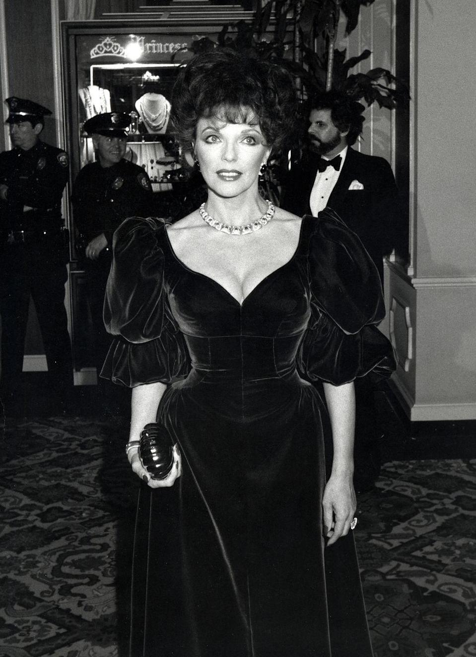 <p>The English actress went for old-school Hollywood glamour in 1982, donning a velvet gown with a plunging neckline and billowy sleeves.</p>