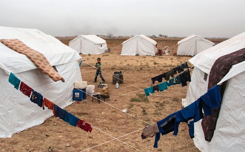 Tents housing displaced Syrians are seen in camp on the southern outskirts of the northern Syrian city of Aleppo on October 22, 2015