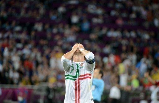 Portuguese forward Cristiano Ronaldo reacts after missing a goal opportunity during the Euro 2012 football championships semi-final match Portugal vs. Spain at the Donbass Arena in Donetsk. Spain reached their third consecutive major tournament final after overcoming neighbours Portugal 4-2 on penalties