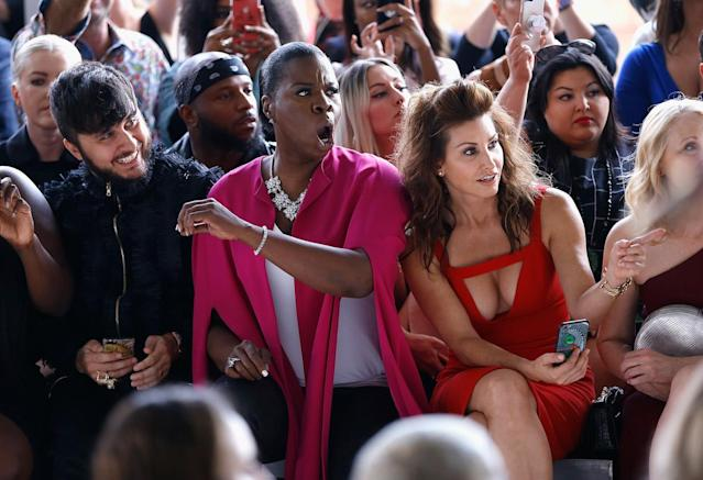 <p>Leslie Jones, attending her first fashion show, sat inbetween Christian Siriano's husband, Brad Walsh, and actress Gina Gershon. (Photo: Getty Images) </p>