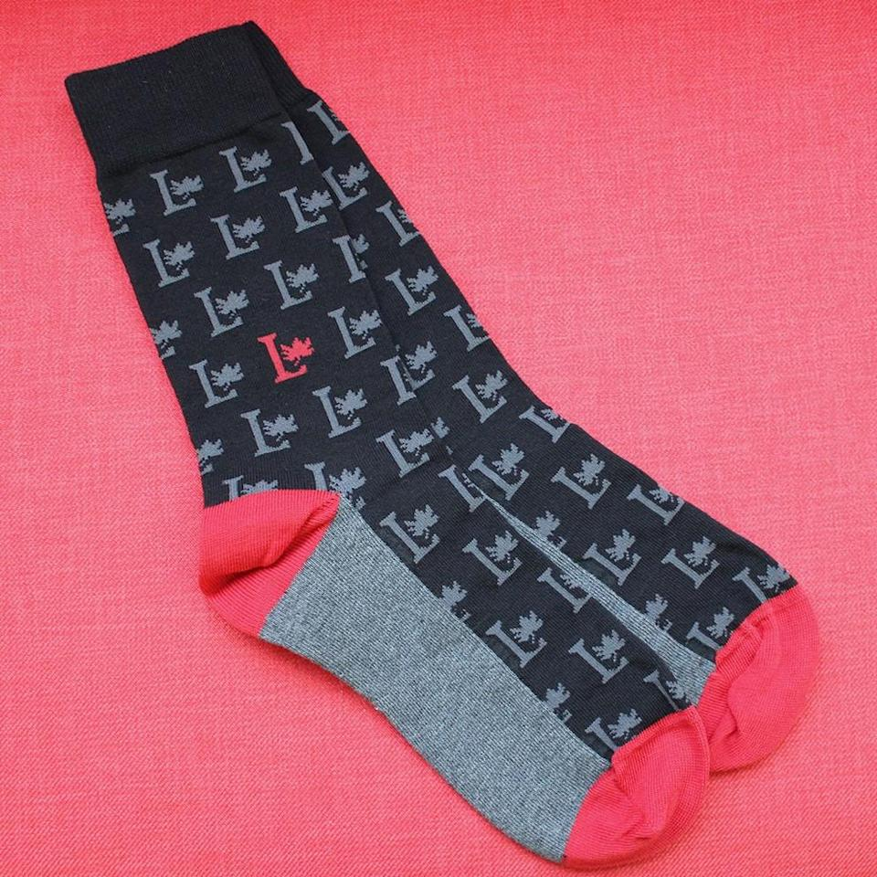"""<p>A pair of Liberal logo patterened socks makes a classic holiday gift. Prime Minister Trudeau has included these in some of his #OOTD. <a href=""""http://bit.ly/2fLBvGq"""" rel=""""nofollow noopener"""" target=""""_blank"""" data-ylk=""""slk:Liberal.ca"""" class=""""link rapid-noclick-resp"""">Liberal.ca</a> </p>"""