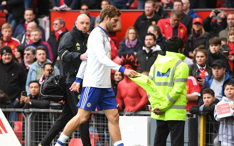 Marcos Alonso of Chelsea leaves the pitch following the warm up prior to the Premier League match between Manchester United and Chelsea - Credit: GETTY
