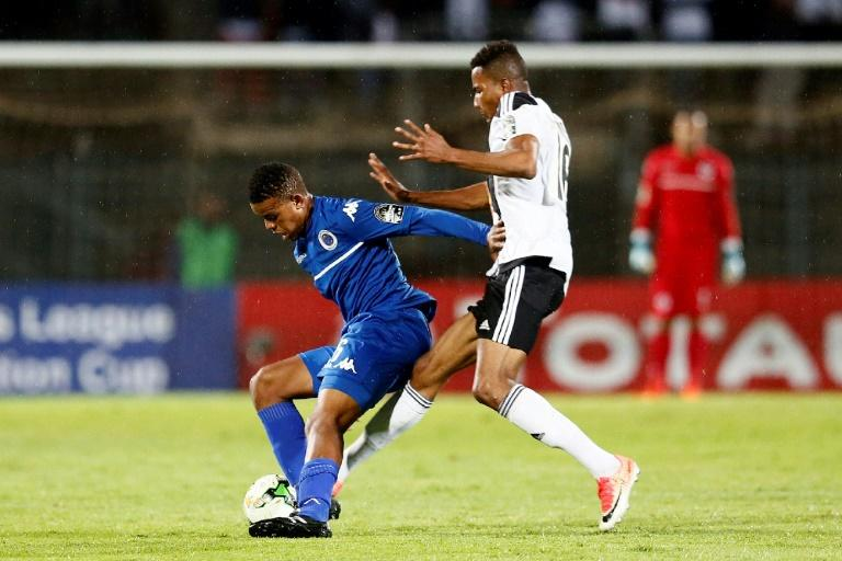 A file photo of SuperSport United midfielder Sipho Mbule (L), who scored the only goal in a South African Premiership match against Bidvest Wits in Johannesburg Friday