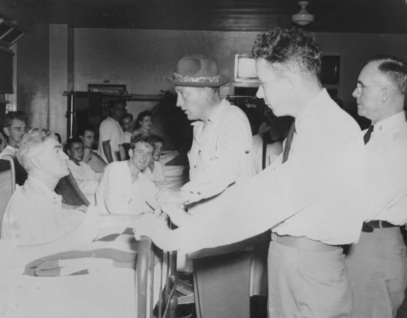Crosby visits soldiers in a military hospital. | Courtesy of the Crosby Family