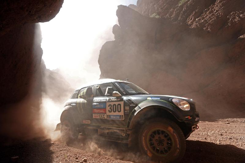 Mini driver Stephane Peterhansel and co-pilot Jean Paul Cottret, both of France, race during the Dakar Rally between the cities of San Miguel de Tucuman and Salta, Argentina, Friday, Jan. 10, 2014