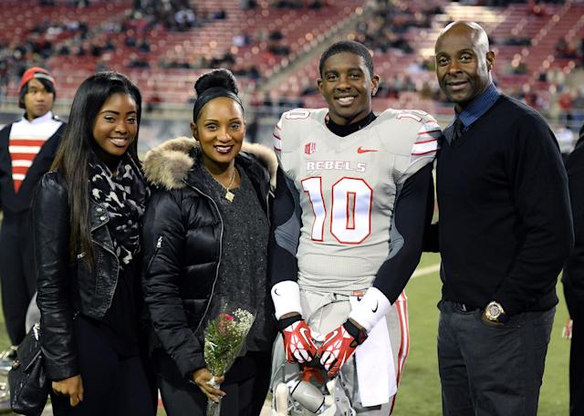 LAS VEGAS, NV - NOVEMBER 30: Jerry Rice Jr. #10 of the UNLV Rebels poses with (L-R) his sister Jada Rice, his mother Jackie Rice and his father, Hall of Fame National Football League player Jerry Rice, during senior night festivities on the field before UNLV's game against the San Diego State Aztecs at Sam Boyd Stadium on November 30, 2013 in Las Vegas, Nevada. (Photo by Ethan Miller/Getty Images)