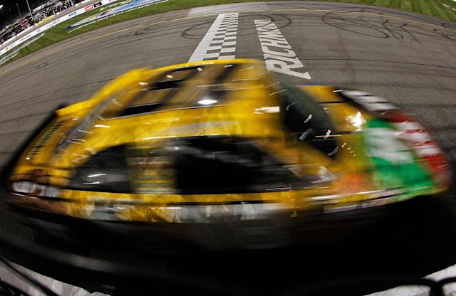 RICHMOND, VA - APRIL 28: Kyle Busch, driver of the #18 M&M's Ms. Brown Toyota, crosses the finish line to win the NASCAR Sprint Cup Series Capital City 400 at Richmond International Raceway on April 28, 2012 in Richmond, Virginia. (Photo by Tom Pennington/Getty Images for NASCAR)