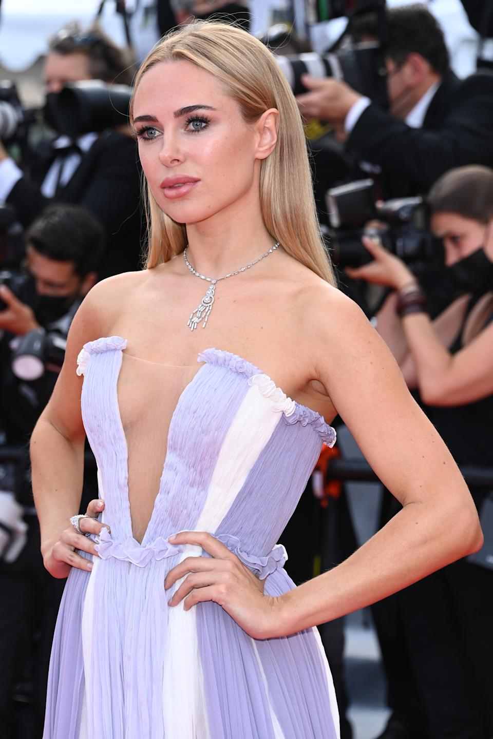Kimberley Garner wears a lilac and white gown at the
