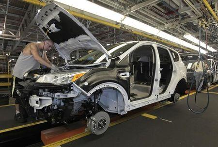 File photo of Louisville Assembly Plant employees assembling the 2013 Ford Escape on the production line in Louisville