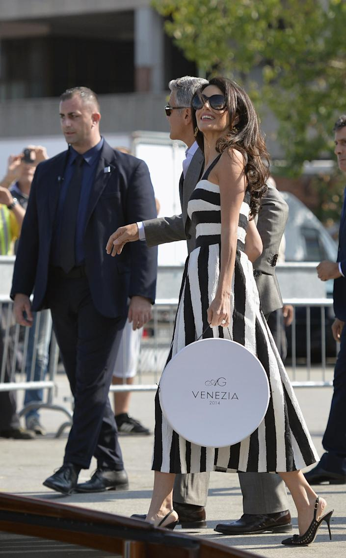 George Clooney (C) and Amal Alamuddin arrive at Venice's Piazzale Roma on September 26, 2014, on the eve of their wedding (AFP Photo/Andreas Solaro)