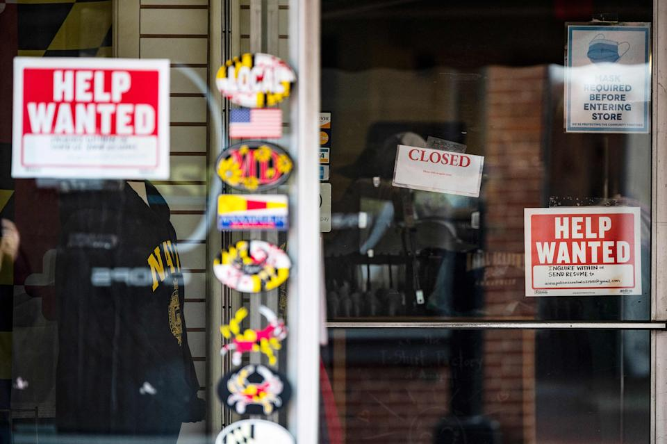 A store advertises a Help Wanted sign in Annapolis, Maryland, on May 12, 2021. - US consumer inflation surged 4.2 percent last month compared to April 2020, the Labor Department said May 12, 2021, posting the biggest year-on-year increase since 2008 as the economy recovered from the pandemic. (Photo by JIM WATSON / AFP) (Photo by JIM WATSON/AFP via Getty Images)