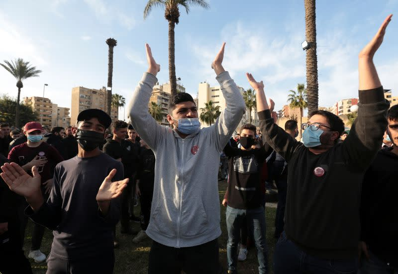 Demonstrators gesture during a protest against the fall in Lebanese pound currency and mounting economic hardships, in Sidon