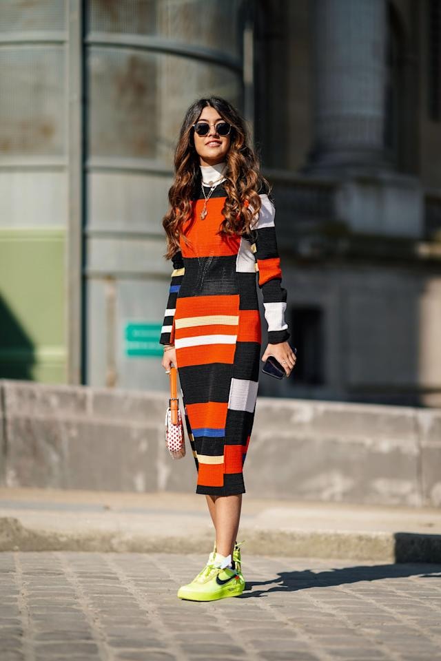 "<p>We saw many an iteration of easy-to-wear striped knit dresses on the runways, from thick colorblocking to <a href=""https://www.popsugar.com/fashion/how-to-wear-ombre-shopbop-47094246"" class=""ga-track"" data-ga-category=""Related"" data-ga-label=""https://www.popsugar.com/fashion/how-to-wear-ombre-shopbop-47094246"" data-ga-action=""In-Line Links"">ombré</a> stripes. It's the perfect off-duty dress when you want to look cute but stay casual, though it can easily be dressed up with heels and a blazer for the office or a nice dinner.</p>"