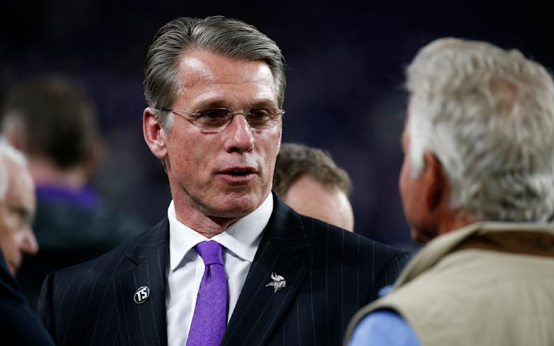 FILE - In this Oct. 28, 2018, file photo, Minnesota Vikings general manager Rick Spielman, left, stands on the field before an NFL football game against the New Orleans Saints in Minneapolis. Vikings President Mark Wilf issued a statement of confidence in Spielman and head coach Mike Zimmer on Friday, Jan. 3, 2020, tamping down speculation about their future two days prior to the team's playoff game. (AP Photo/Bruce Kluckhohn, File)