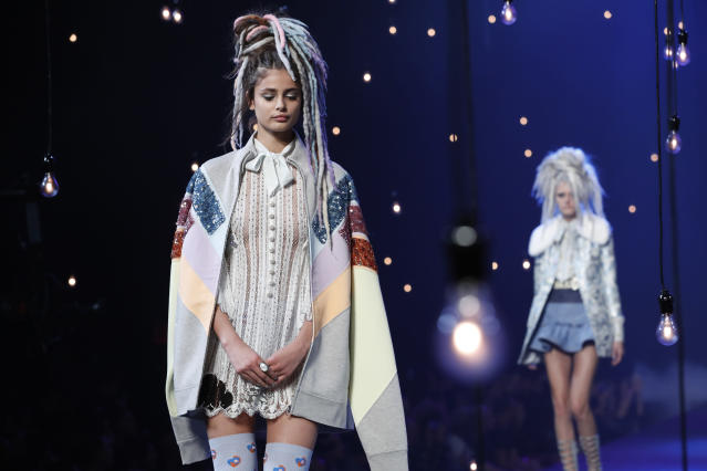 <p>For his most controversial runway hairstyle yet, models of all ethnicities wore multicolored faux dreadlocks. (Photo: AP Images) </p>