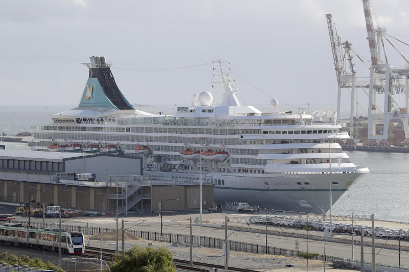 This Friday, March 27, 2020, photo shows the cruise ship Artania docked at Fremantle harbour in Fremantle, Australia. Authorities were still hoping to fly 800 cruise ship passengers from Australia to Germany on the weekend, but a sharp overnight rise in cases of the new coronavirus on board brought severe complications for the repatriation mission. (Richard Wainwright/AAP Image via AP)