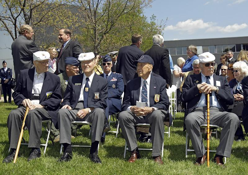 Four surviving members of the Doolittle Raiders, front row from left: Thomas C. Griffin, David J. Thatcher, Richard E. Cole and Edward J. Saylor, wait for a second flyover of B-25s at the National Museum of the United States Air Force in Dayton, Ohio commemorating the 70th anniversary of the Doolittle raid on Tokyo Wednesday, April 18, 2012. (AP Photo/Mark Duncan)