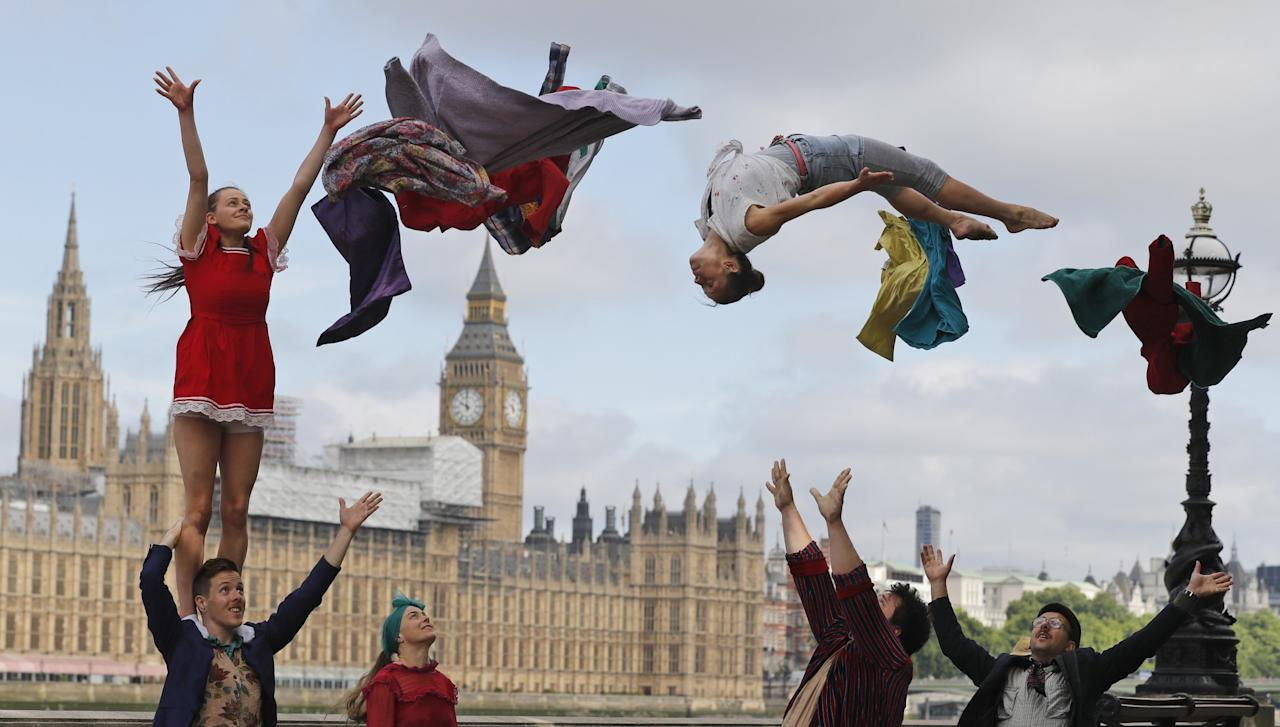 <p></p><p>Circus artists perform stunts opposite the Houses of Parliament. (AP Photo/Frank Augstein) </p><p></p>