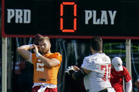 Tampa Bay Buccaneers quarterback Kyle Trask (2) throws a pass to tackle Robert Hainsey (70) during an NFL football minicamp Tuesday, June 8, 2021, in Tampa, Fla. (AP Photo/Chris O'Meara)