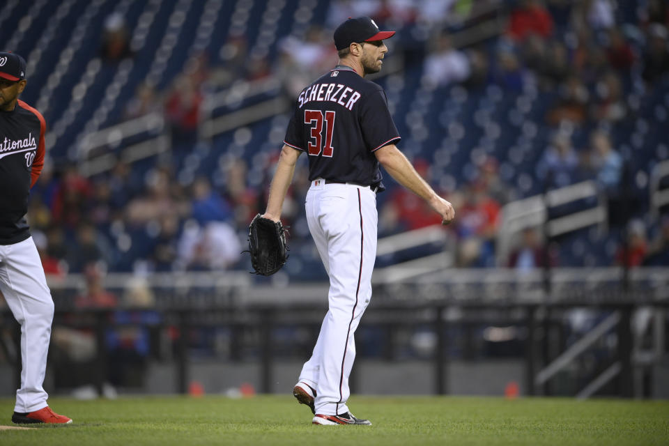 Washington Nationals starting pitcher Max Scherzer (31) leaves the team's baseball game against the San Francisco Giants with an injury during the first inning Friday, June 11, 2021, in Washington. (AP Photo/Nick Wass)