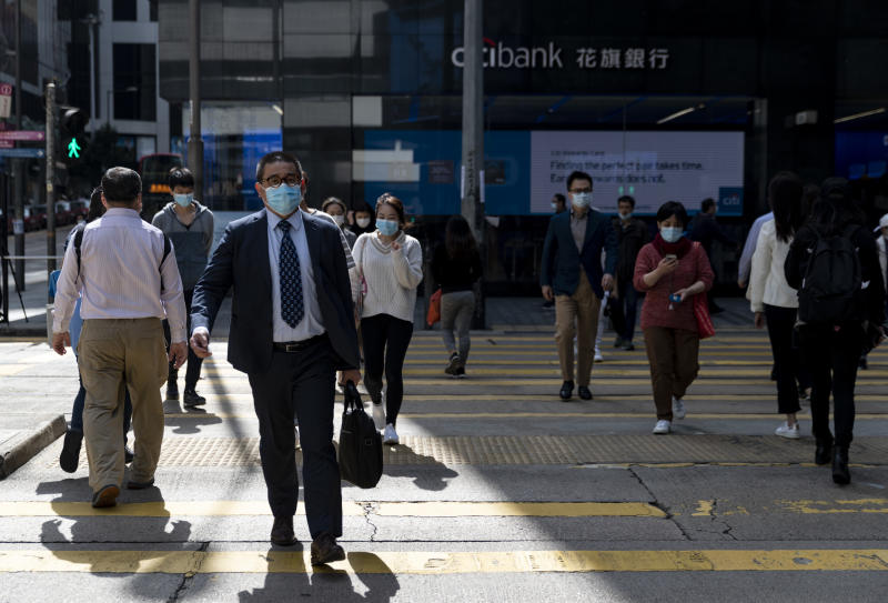 A business man wearing a face mask crosses the road in central, a heart of business and financial district. Stock markets are falling around the world after sudden escalate coronavirus cases in South Korea and Italy in the last few days. Total at least 79,300 confirmed coronavirus-related cases globally and more than 2,620 deaths worldwide. (Photo by May James / SOPA images/Sipa USA)