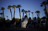 People attend an Easter sunrise service at the Palm Eastern Mortuary and Cemetery, Sunday, April 4, 2021, in Las Vegas. (AP Photo/John Locher)
