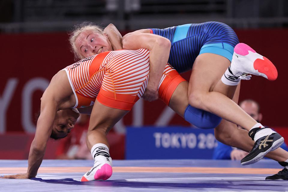 <p>India's Vinesh Vinesh (red) wrestles Sweden's Sofia Magdalena Mattsson in their women's freestyle 53kg wrestling early round match during the Tokyo 2020 Olympic Games at the Makuhari Messe in Tokyo on August 5, 2021. (Photo by Jack GUEZ / AFP)</p>