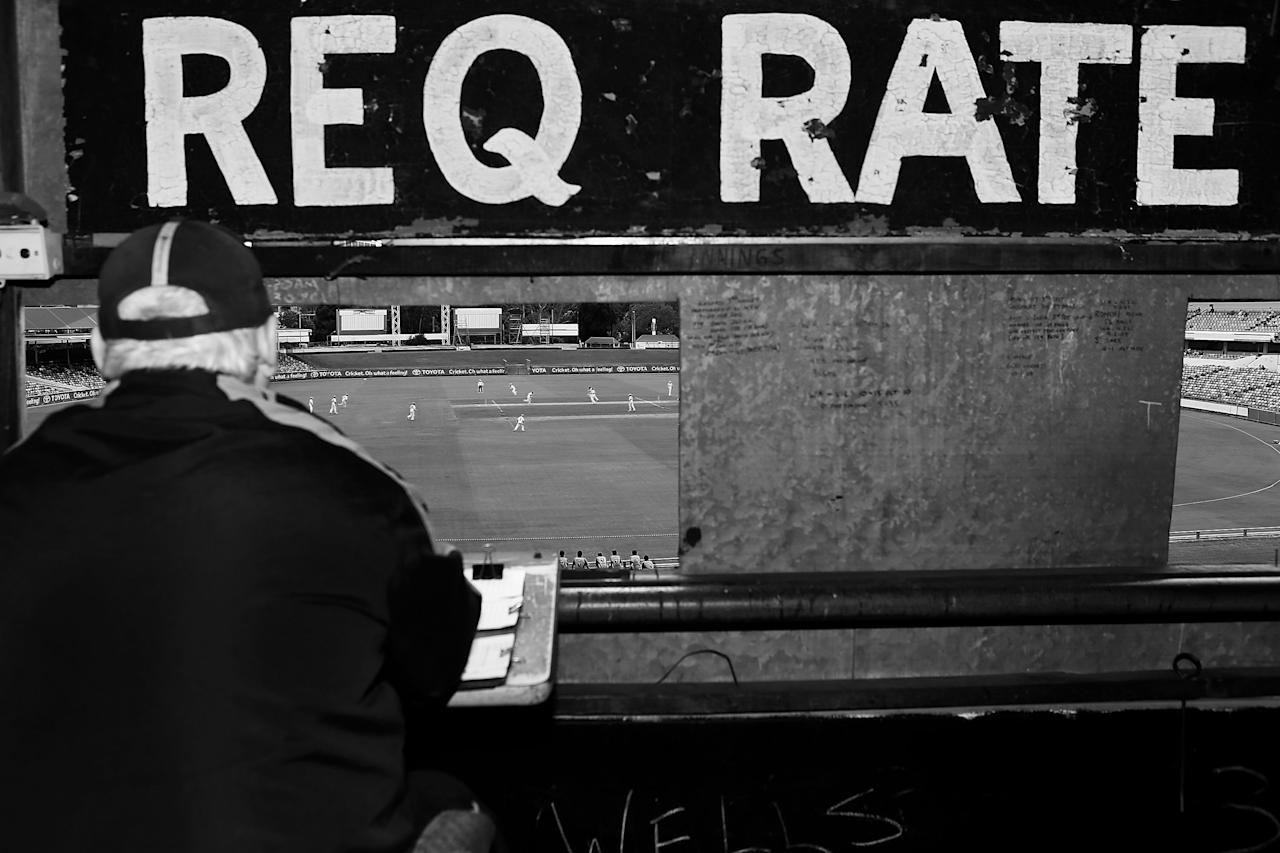 PERTH, AUSTRALIA - FEBRUARY 22: (EDITORS NOTE: Image has been converted to black and white.) A scoreboard attendant watches procedings from the old WACA scoreboard during day two of the Sheffield Shield match between the Western Australia Warriors and the Tasmania Tigers at WACA on February 22, 2013 in Perth, Australia.  (Photo by Paul Kane/Getty Images)
