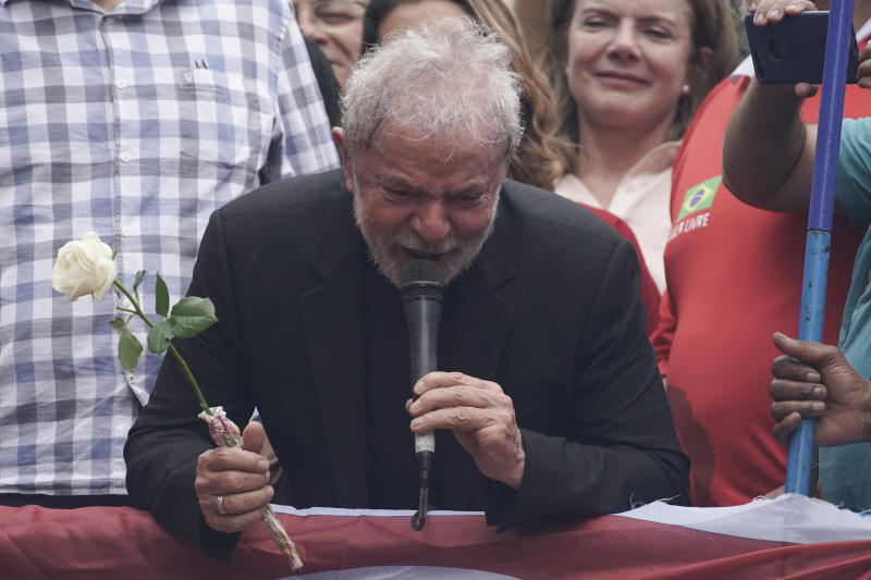 """Former Brazilian President Luiz Inacio Lula da Silva thanks a supporter for the rose he was handed during a rally at the Metal Workers Union headquarters, in Sao Bernardo do Campo, Brazil, Saturday, Nov. 9, 2019. Da Silva addressed thousands of jubilant supporters a day after being released from prison. """"During 580 days, I prepared myself spiritually, prepared myself to not have hatred, to not have thirst for revenge,"""" the former president said. (AP Photo/Leo Correa)"""