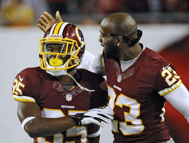 Washington Redskins running back Chris Thompson (35) celebrates with teammate DeAngelo Hall (23) after scoring on a 69-yard punt return against the Tampa Bay Buccaneers during the first quarter of an NFL preseason football game Thursday, Aug. 29, 2013, in Tampa, Fla. (AP Photo/Brian Blanco)