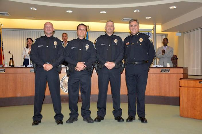 A photograph posted on social media by the North Miami Beach police department on June 8, 2016, shows Nicholes Lentz (far left) being sworn in as an officer.