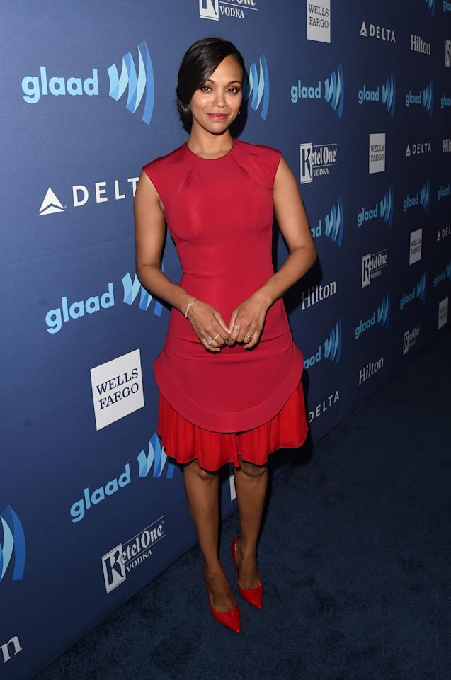 The new mother-of-two stunned in a skin-tight red dress with matching red pumps.