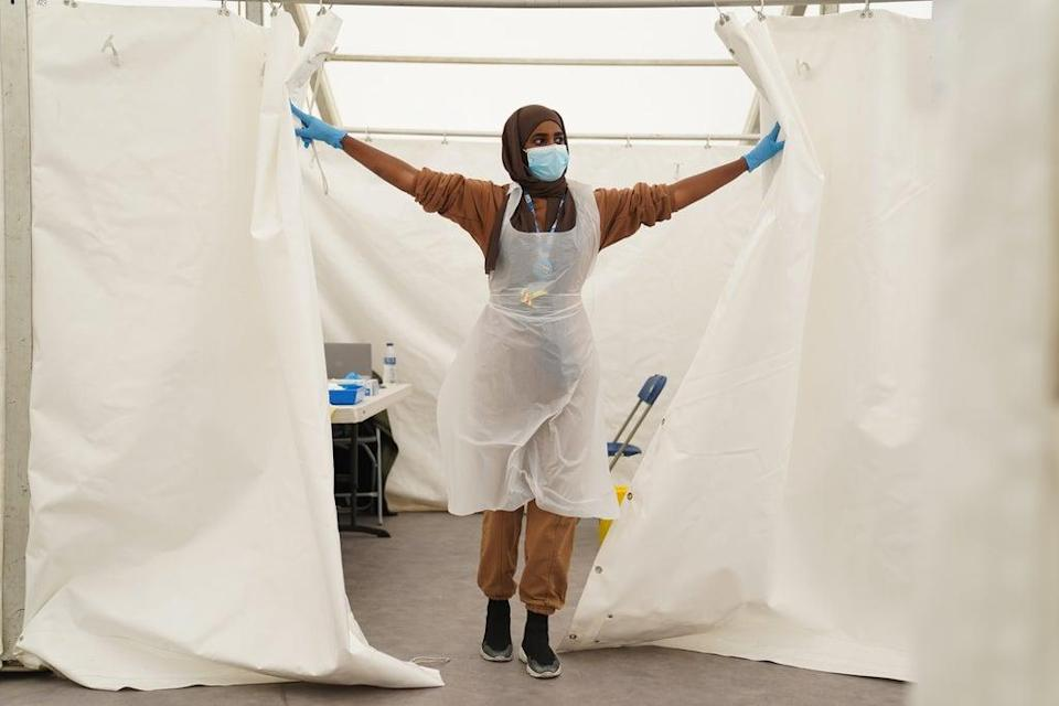 An NHS worker looks for patients at a Covid-19 pop-up vaccination centre in Langdon Park, Poplar, east London (Kirsty O'Connor/PA) (PA Wire)