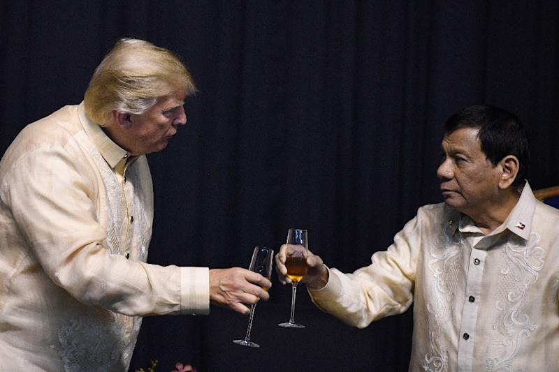 Trump (L) has so far appeared to be a fan of Duterte (R) (AFP Photo/JIM WATSON)