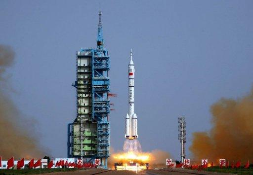 The Shenzhou-9 -- China's fourth manned space mission -- blasts off from the Jiuquan space base, northwest China's Gansu province in the remote Gobi desert. China launched its most ambitious space mission to date, sending its first female astronaut into orbit and bidding to achieve the country's first manual space docking
