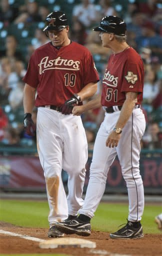 Houston Astros' Brian Bogusevic (19) is congratulated by first base coach Dan Radison (51) after hitting an RBI-single during the fifth inning of a baseball game against the Cincinnati Reds, Sunday, Sept. 2, 2012, in Houston. (AP Photo/Dave Einsel)