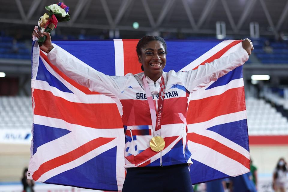 IZU, JAPAN - AUGUST 27: Kadeena Cox of Team Great Britain celebrates on the podium after winning gold during the medal ceremony for the Track Cycling Women's C4-5 500m Time Trial on day 3 of the Tokyo 2020 Paralympic Games at Izu Velodrome on August 27, 2021 in Izu, Shizuoka, Japan. (Photo by Kiyoshi Ota/Getty Images)