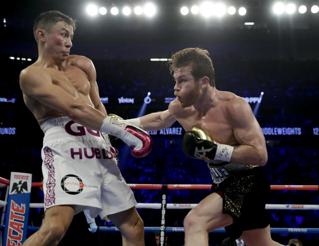 Gennady Golovkin, left, and Canelo Alvarez trade punches in the second round during a middleweight title boxing match, Saturday, Sept. 15, 2018, in Las Vegas. (AP Photo/Isaac Brekken)