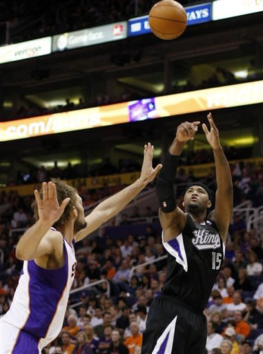 Sacramento Kings forward DeMarcus Cousins, right, shoots against Phoenix Suns center Robin Lopez in the second quarter of an NBA basketball game on Sunday, March 4, 2012, in Phoenix, Ariz. (AP Photos/Rick Scuteri)
