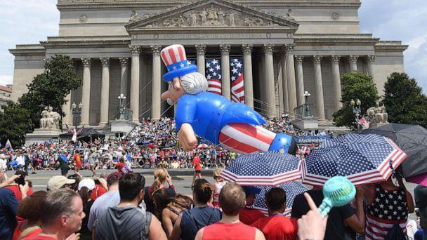 PHOTO: People watch the Independence Day parade as it passes in front of the National Archives in Washington, D.C., on July 4, 2019. (Saul Loeb/AFP/Getty Images)