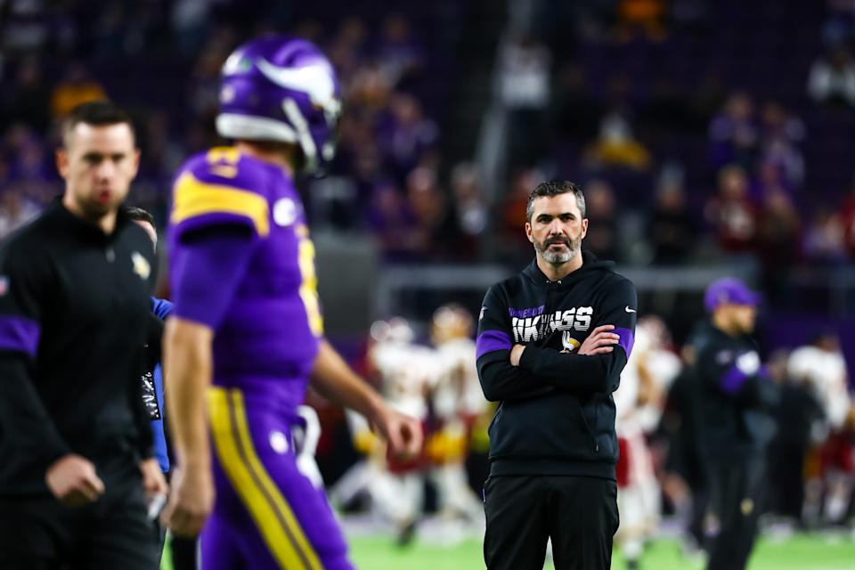 Oct 24, 2019; Minneapolis, MN, USA; Minnesota Vikings quarterback Kirk Cousins (8) participates in warm ups while offensive coordinator Kevin Stefanski looks on before the start of a game against the Washington Redskins at U.S. Bank Stadium. Mandatory Credit: David Berding-USA TODAY Sports