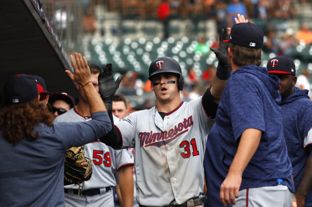Minnesota Twins' Tyler Austin (31) celebrates in the dugout after scoring in the fourth inning of a baseball game against the Detroit Tigers in Detroit, Wednesday, Sept. 19, 2018. (AP Photo/Paul Sancya)