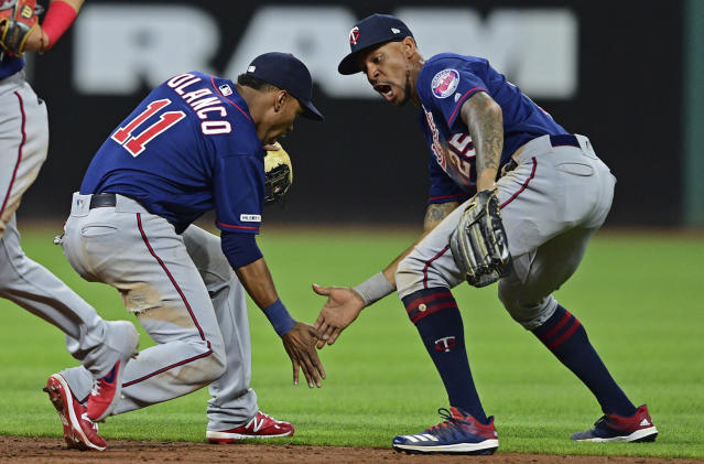 Minnesota Twins' Byron Buxton, right, and Jorge Polanco celebrate after defeating the Cleveland Indians in a baseball game, Friday, July 12, 2019, in Cleveland. (AP Photo/David Dermer)