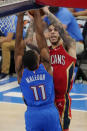 New Orleans Pelicans guard Lonzo Ball, right, shoots over Oklahoma City Thunder guard Theo Maledon (11) in the second half of an NBA basketball game Thursday, Dec. 31, 2020, in Oklahoma City. (AP Photo/Sue Ogrocki)